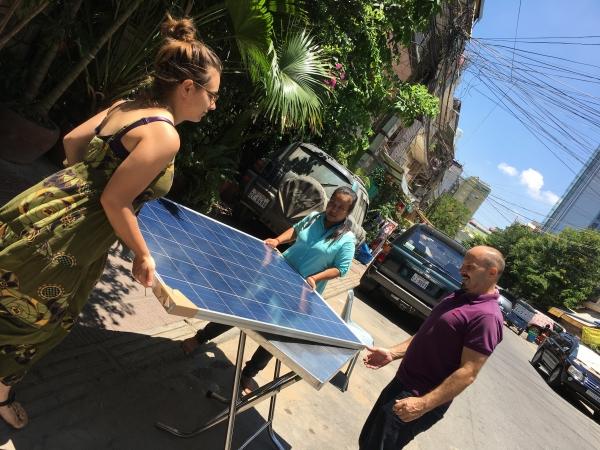 NRG Solutions / Krousar Solar staff installs a large solar panel