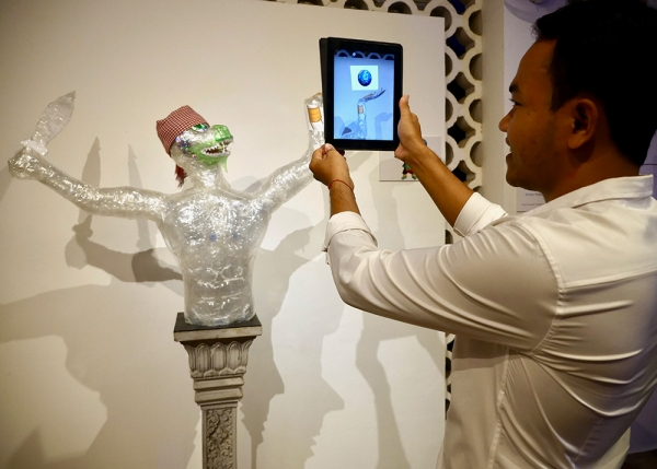 A Hanuman scupture build by the Plastic Commune team triggers an augmented reality image of the earth carried in his hand.