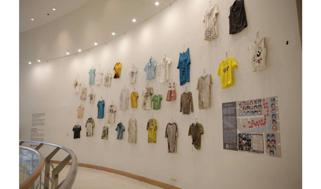 Community t-shirts on display. Photo by Scott Kildall.